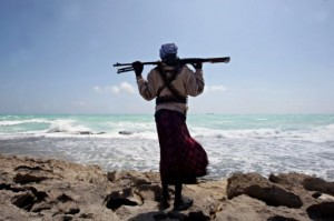 A-Somali-pirate-looks-on-as-a-Greek-cargo-ship-is-anchored-off-of-Somalia-where-its-being-held-by-pirates-AFP-File-Mohamed-Dahir-300x199.jpg